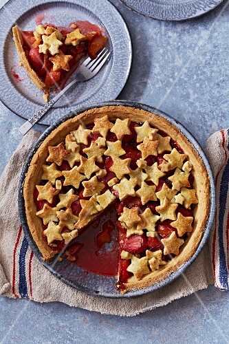 Apple and strawberry pie decorated with shortcrust stars
