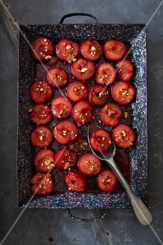 Baked plums with hazelnuts (seen from above)