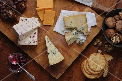 An English cheese platter with chutney, crackers and walnuts