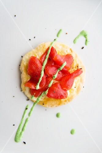 A mini tomato pizza with goat's cheese coriander pesto