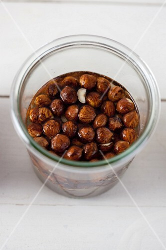 Hazelnuts being softened in water to create hazelnut milk