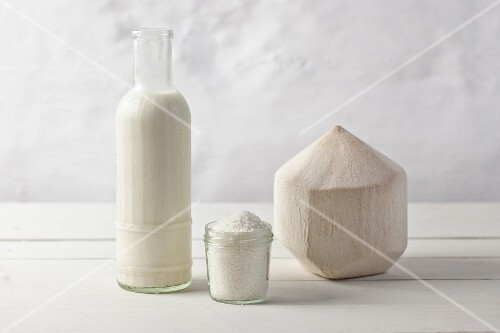 Coconut milk, grated coconut and a whole coconut