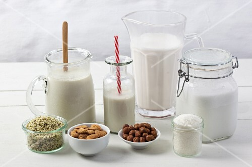 Various types of vegan milk with ingredients