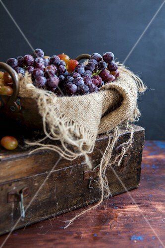 An arrangement of grapes with a piece of jute