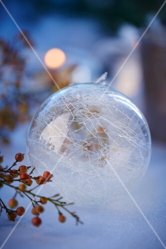 A transparent filigree Christmas bauble as decoration