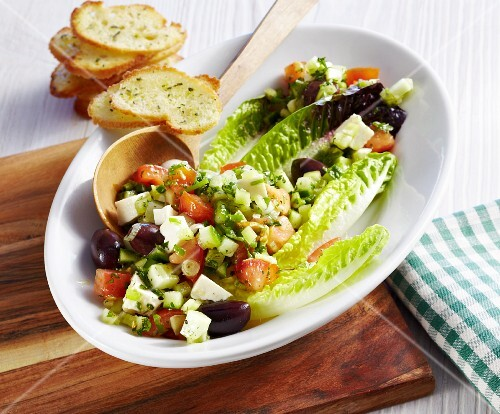 Cos lettuce with cucumber, tomatoes, olives, feta cheese and sage bread thins