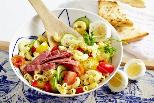 Amsterdam pasta salad with cherry tomatoes, hard-boiled eggs and corned beef