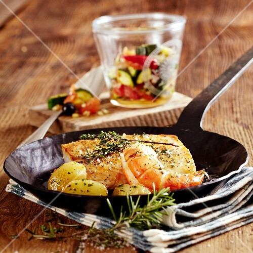 Fillet of Nile perch with prawns and potatoes