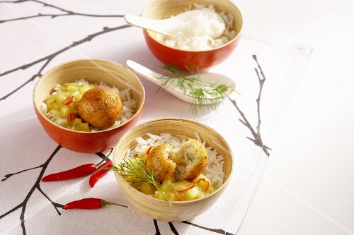 Cod balls in a fruity curry sauce on a bed of rice (Asia)