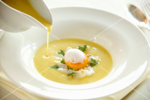 Creamy fish soup with a poached egg