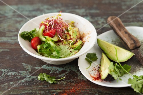 Avocado salad with bean sprouts and chilli and soya yoghurt