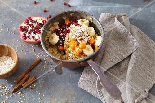 Warm millet breakfast with fruit and cinnamon (vegan)