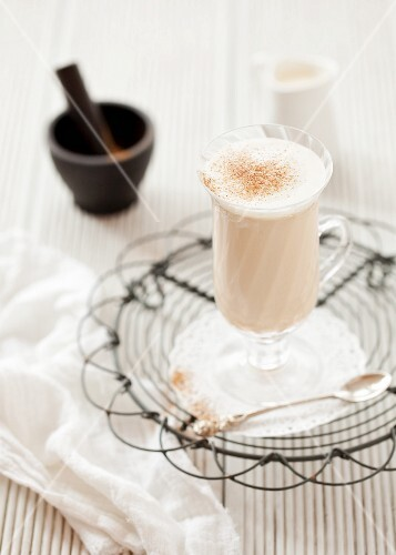 Chai latte in a glass cup