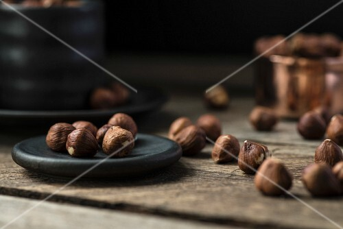 Hazelnuts on a plate and in a cup