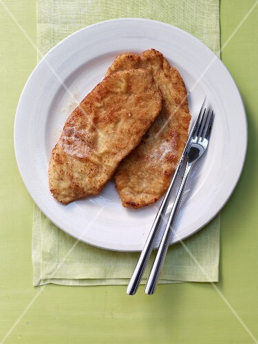 To Viennese escalopes on a plate (seen from above)