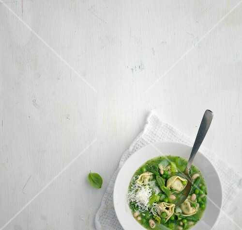 Summer minestrone with green vegetables and tortellini