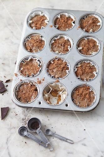 Vegan chocolate and hazelnut tartlets in a muffin tin