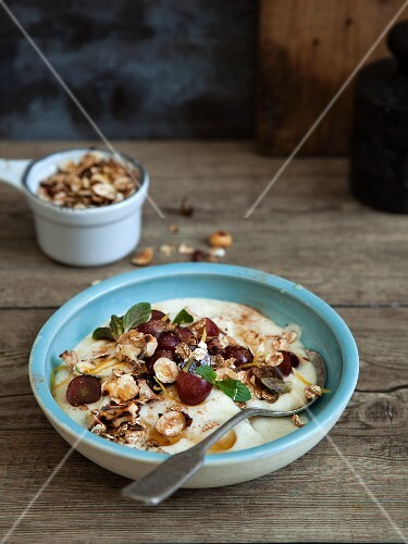 Vegan almond yoghurt with grapes and nuts
