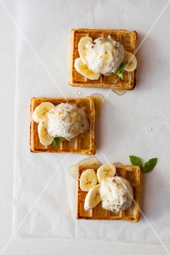 Waffles with coconut and almond ice cream and banana slices