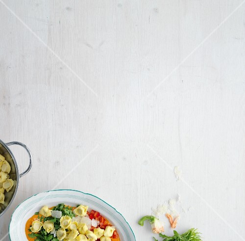 Tortellini with tomatoes, rocket and Parmesan cheese