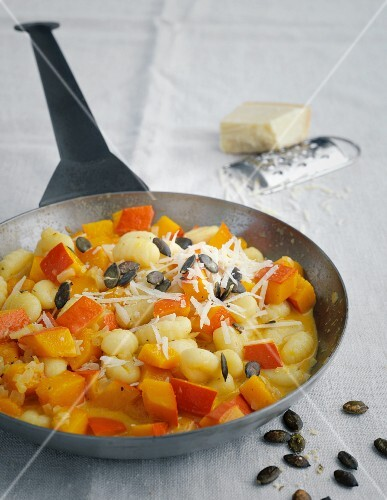 Gnocchi with pumpkin in a creamy sauce with pumpkin seeds and Parmesan cheese