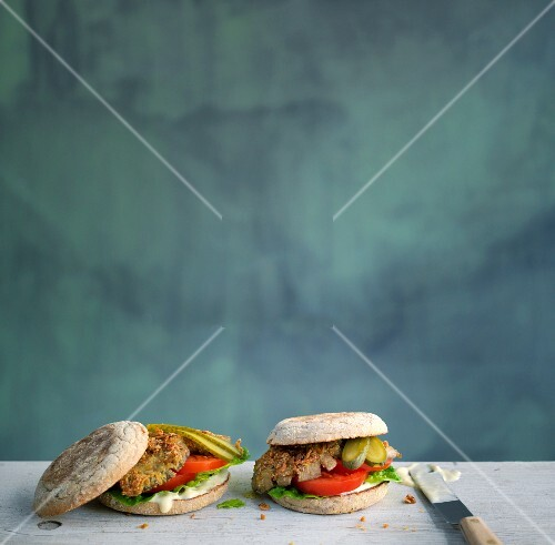 Mushroom burgers with tomatoes and gherkins