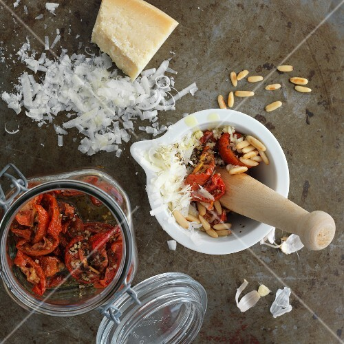 Ingredients for tomato pesto in a mortar