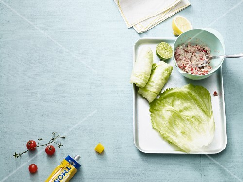Lettuce wraps filled with tuna being made (low carb)
