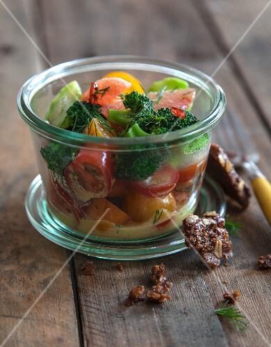 Vegan tomato and grapefruit salad with broccoli