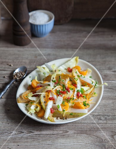 Vegan chicory salad with pears and physalis