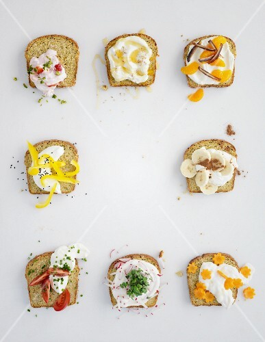 Eight different spreads made from quark, cream cheese, fruit and vegetables