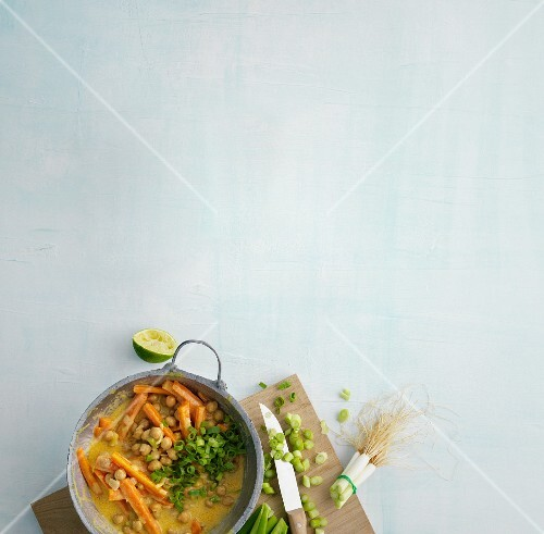 Chickpea and carrot curry with spring onions