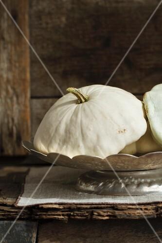 White pattypan squash in a silver dish
