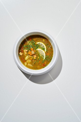 Aguadito de pollo (chicken soup with rice, vegetables and Peruvian spices in a citrus-herb broth)