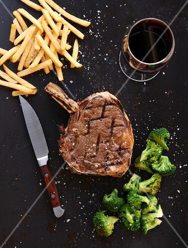 Prime rib steak with fries and broccoli