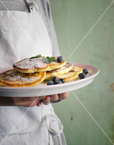 Vegetarian blueberry pancakes with icing sugar