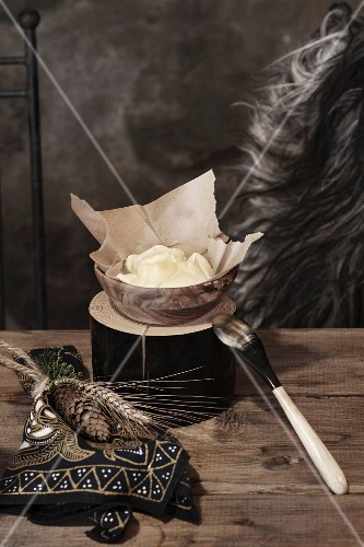 Christmas in a wine cellar: butter in a dish on a rustic wooden table