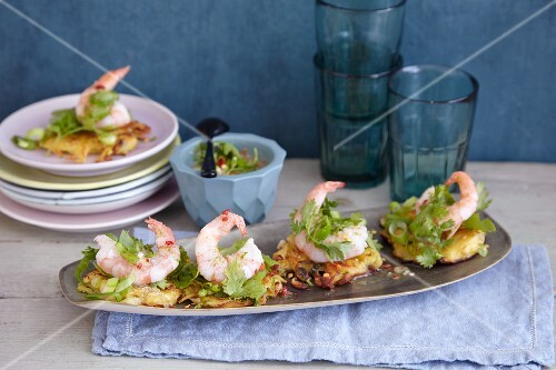 Mini potato fritters with prawns, coriander and limes