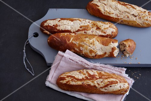 Homemade lye bread baguettes with bacon
