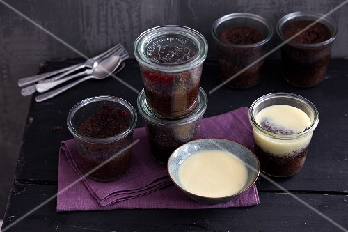 Chocolate cake in jars with cherry compote and white chocolate