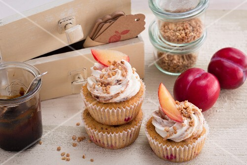 Plum and nut cupcakes with a sour cream topping