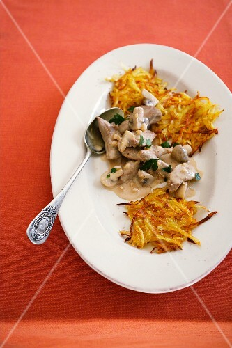 Pork with pumpkin and ginger fritters