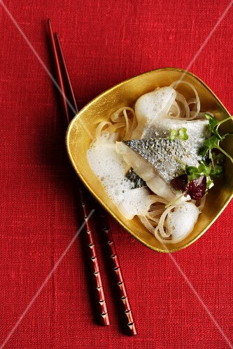 Poached branzini with glass noodles in a ginger and coconut broth