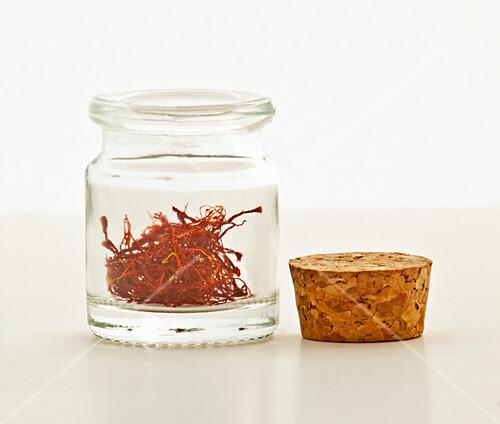 Saffron threads in a small bottle