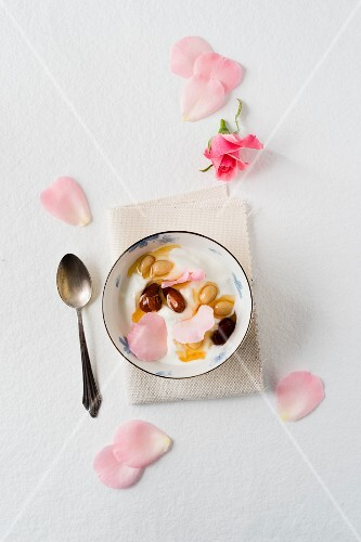 Yoghurt with almonds preserved in honey and rose petals