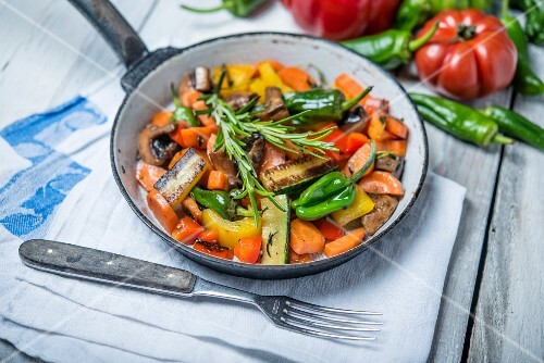Fried vegetables with mushrooms and rosemary