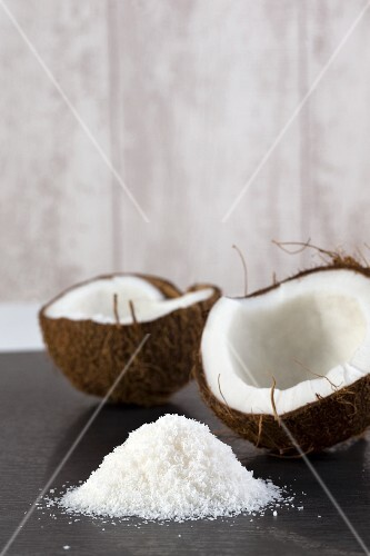 A half coconut with grated coconut