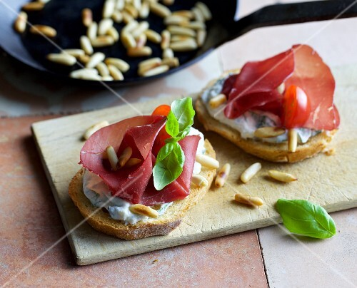 Crostini with ricotta, bresaola and pine nuts