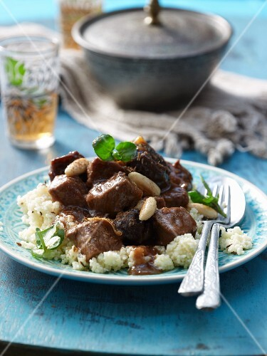Beef tagine with almonds and baked plums