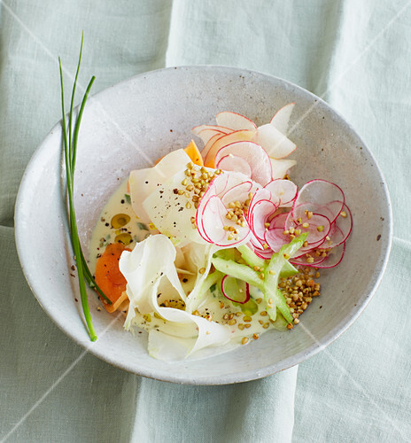 Apple carpaccio with fresh vegetables and buckwheat